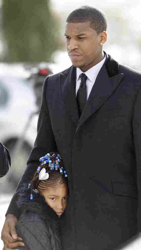 Kansas basketball player Thomas Robinson and his 9-year-old sister, Jayla, arrive for the funeral of their mother, Lisa, on Jan. 27, 2011, at Antioch Baptist Church in Washington, D.C. Robinson's mother and grandparents died within a few weeks of each other.