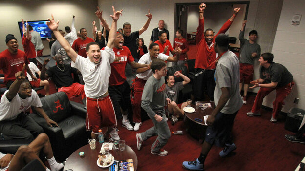 The University of Alabama's players celebrate their No. 8 seeding in the NCAA Men's Basketball Tournament while watching Sunday's selection show in Tuscaloosa. The Crimson Tide, a veteran bunch, will play the upstart mid-major Creighton on Friday.