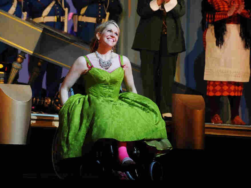 Joyce DiDonato performs in her wheelchair and pink cast after breaking her leg in a production of  Rossini's Barber of Seville, at London's Royal Opera House.