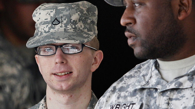 Army Pfc. Bradley Manning, left, is escorted from a courthouse in Fort Meade, Md.
