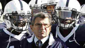 Penn State head coach Joe Paterno stands with his team before they take the field during an NCAA college football game against the University of Wisconsin in State College, Pa., on Oct. 13, 2007.
