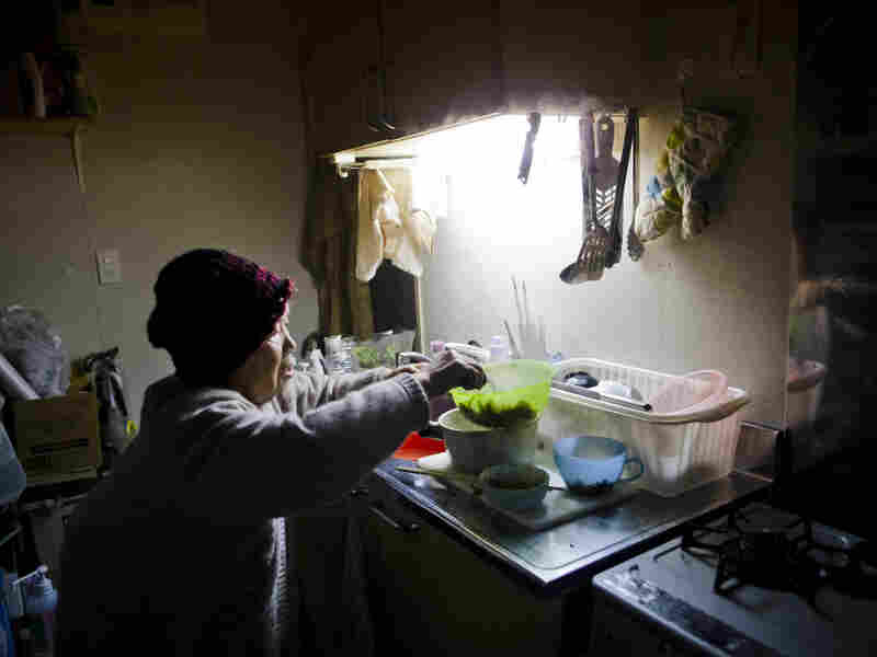 Last year's tsunami destroyed Tamiko Abe's house, and a year later, the 71-year-old (shown here March 5, 2012) still lives in temporary housing.