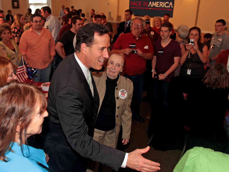 Rick Santorum greets supporters during a rally at L
