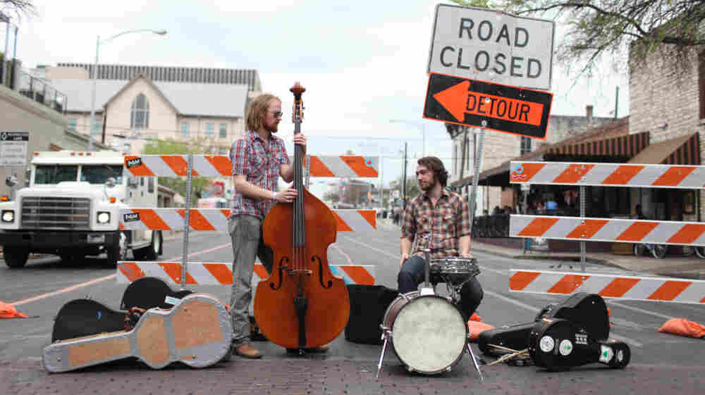 Every Flat Surface: Jay Cobb Anderson (left) and Tyler Thompson on the street at SXSW 2011 in Austin, Texas.
