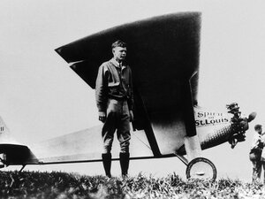 American aviator Charles Lindbergh poses in front of his monoplane Spirit of St-Louis at Paris-Le Bourget, May 21 1927, after having achieved the first solo non-stop transatlantic flight from New York to Paris.