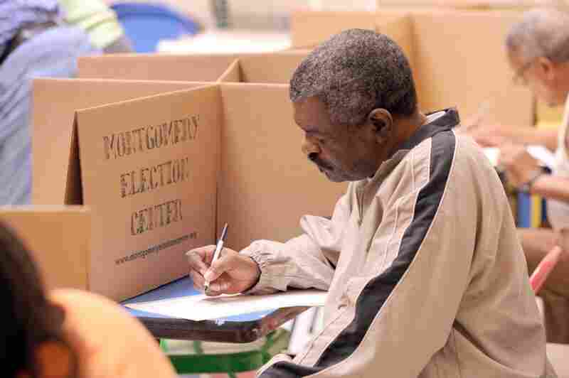 A voter casts his ballot at the Montgomery Museum of Fine Art in Montgomery, Ala.