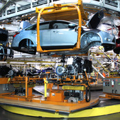 Workers build cars on the assembly line at the Ford Motor Co.'s Michigan Assembly Plant in Wayne, Mich., in December. As auto sales boom, parts suppliers are having a tough time finding the labor they need to catch up, having lost workers during the recession.