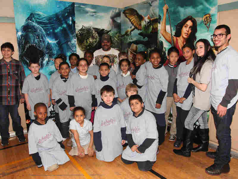 """New York Native, Luis Guzman, Starring in """"Journey 2: The Mysterious Island,"""" poses with some lucky New York City Public School students at Henry Street Settlement on Feb. 7, 2012 in New York City. The GOP presidential candidates are split on federal education programs."""