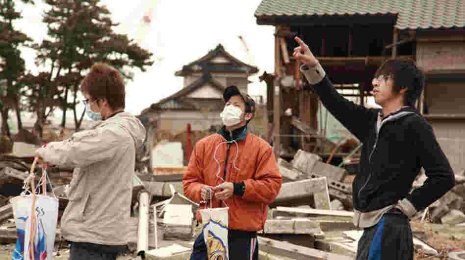 High-school student Kento Ito (right) and friends prepare for a Children's Day ceremony honoring Kento's little brother, Ritsu-kun, and others who perished in the Tohoku earthquake and tsunami of March 2011.