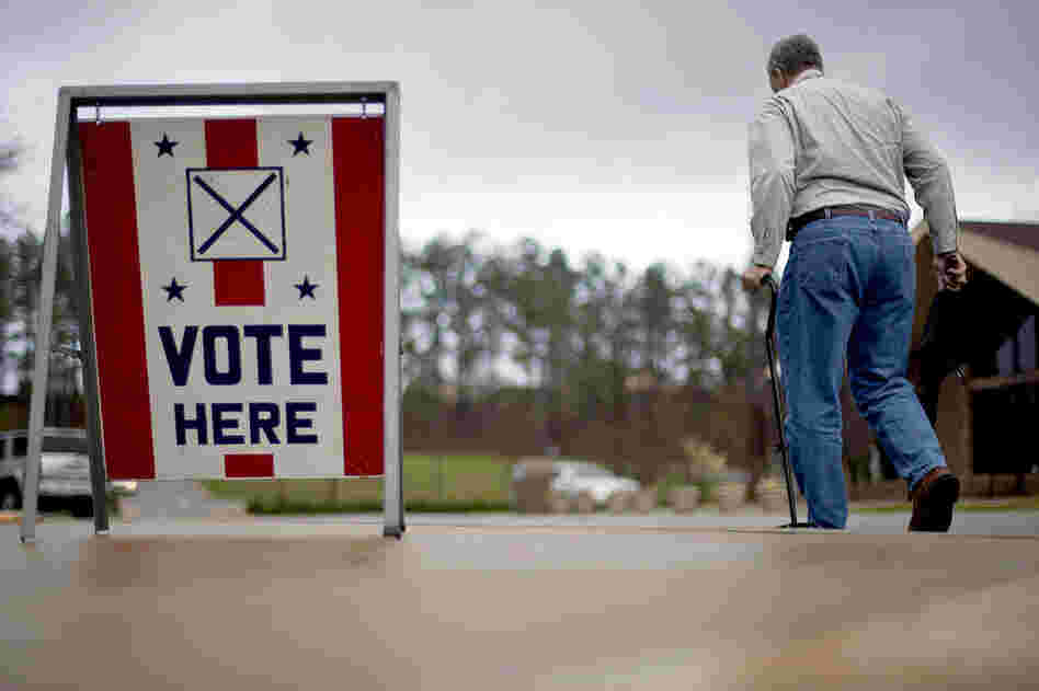 A voter leaves a polling place in Birmingham, Ala. Alabama, Mississippi and Hawaii also held presidential-nominating contests on Tuesday.