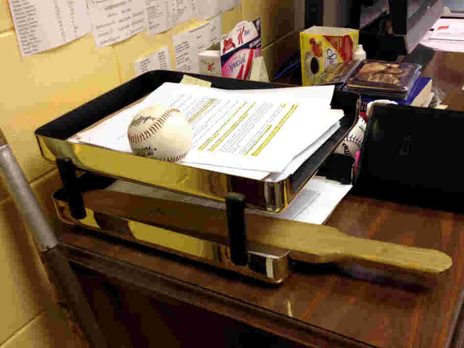 A wooden paddle sits on the principal's desk at Sneads High School in Jackson County, Fla. Almost every county in the state's rural north has policies that allow schools to paddle students.