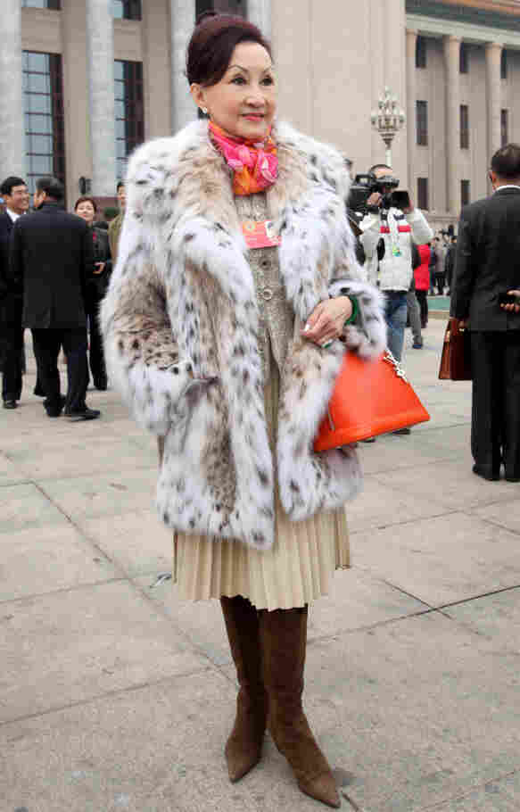 Delegate and Hong Kong cosmetics entrepreneur Cheng Ming Ming carries a Louis Vuitton Alma handbag and wears a fur coat in Beijing, on March 3. Her bag is said to be worth $2,500.