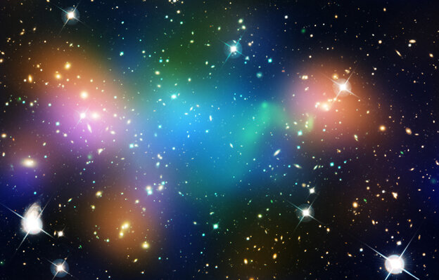 This image of the galaxy cluster Abell 520 — 2.4 billion light-years away — may challenge some of our basic theories about Dark Matter. It is overlaid with false-color maps showing concentrations of starlight (orange), hot gas (green) and mass (blue). The mass is mostly Dark Matter.
