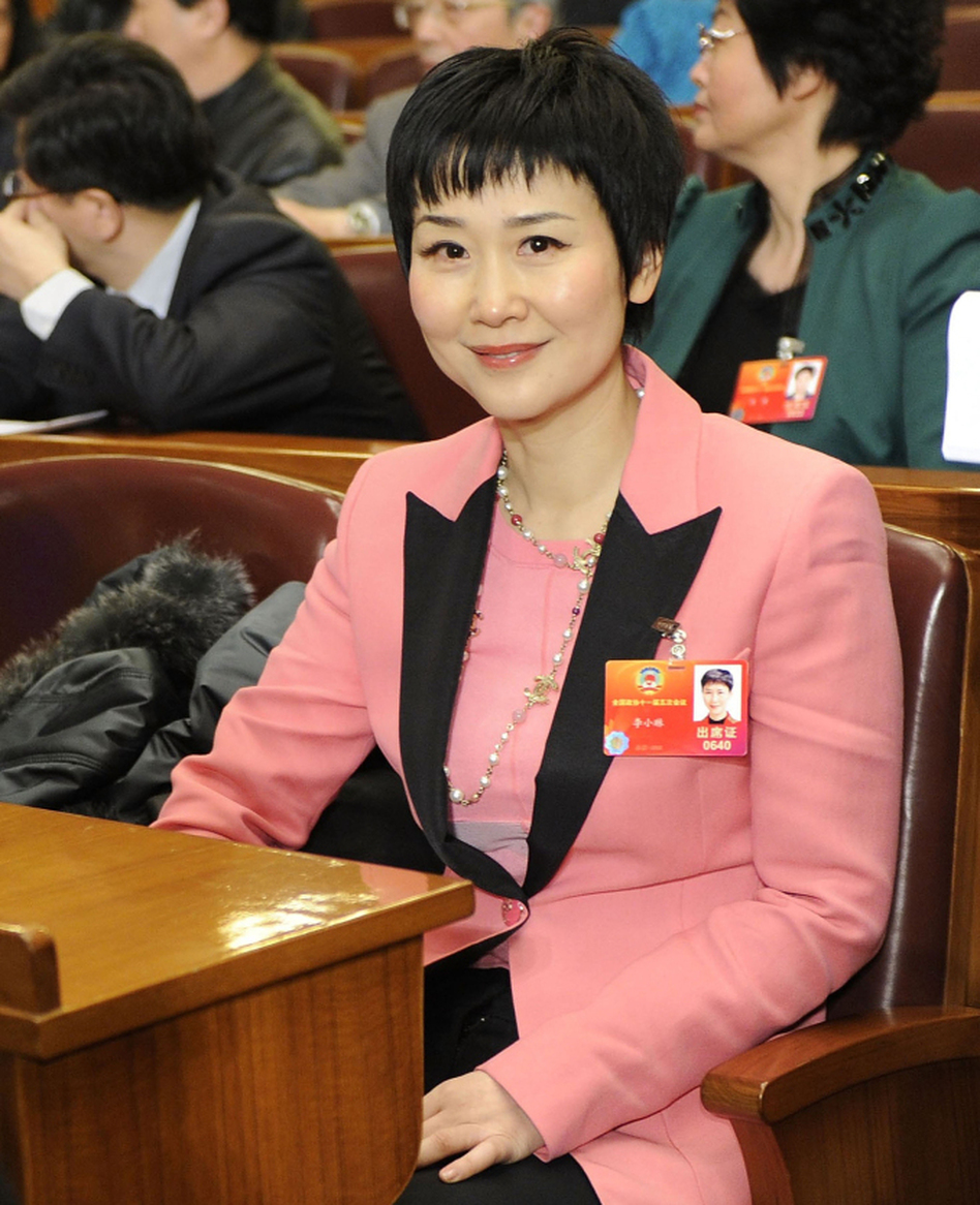 Li Xiaolin, daughter of former Chinese Premier Li Peng, attends the opening ceremony of the CPPCC in Beijing, March 3, 2012. Her suit — by Italian designer Emilio Pucci — is estimated to cost $2,000.