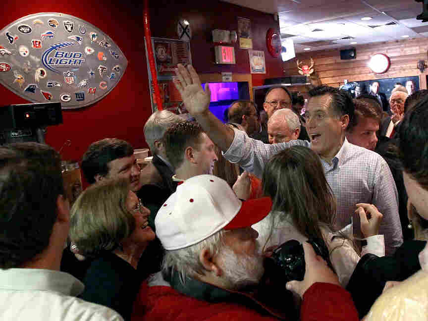 Can Mitt Romney finally win a Southern state Tuesday? Here, Romney greets Alabamans at the Whistle Stop Cafe in