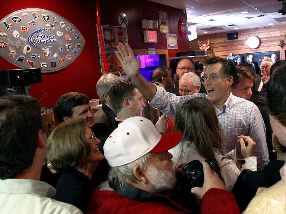 Can Mitt Romney finally win a Southern state Tuesday? Here, Romney greets Alabamans at the Whistle Stop Cafe in Mobile on Monday.