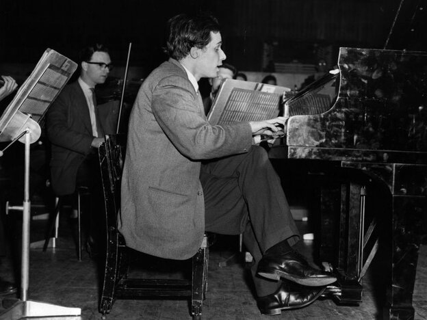 A 1959 picture of Glenn Gould rehearsing at London's Royal Festival Hall. (Yes, he's seated on an abnormally short piano stool, hovering only a few inches above the floor.)