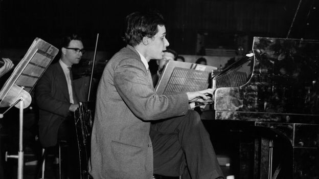 A 1959 picture of Glenn Gould rehearsing at London's Royal Festival Hall. (Yes, he's seated on an abnormally short piano stool, hovering only a few inches above the floor.)  (Getty Images)