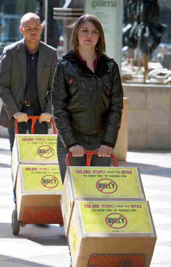 Michigan high school student Katy Butler, 17, and Change.org organizer Mark Anthony Dingbaum deliver petitions with more than 200,000 signatures to the Motion Picture Association of America in Los Angeles on March 7, asking the group to change the R rating on the documentary Bully.