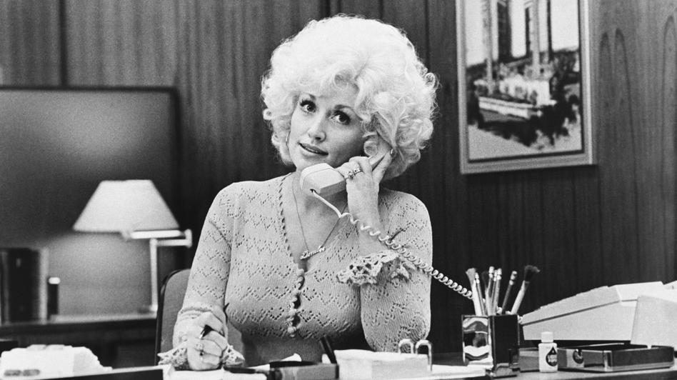 Dolly Parton played the secretary of a lecherous boss in 9 To 5. (AP)
