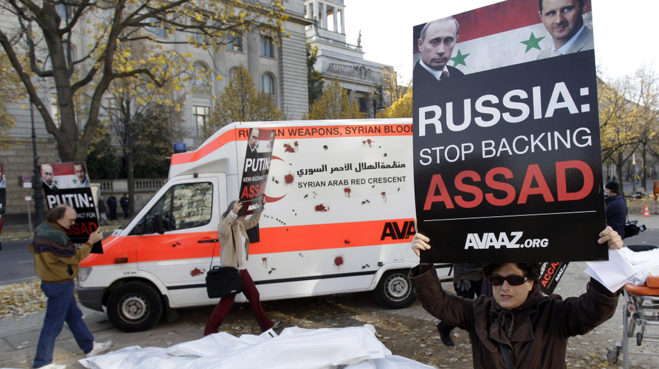 Campaigners from the international advocacy group Avaaz protest Russian arms sales to the Syrian government during a demonstration in front of the Russian Embassy in Berlin on Nov. 2. (AP)