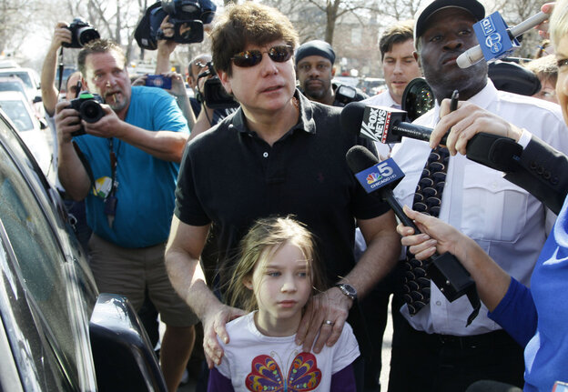 Former Illinois Gov. Rod Blagojevich leaves home with his daughter, Annie, before his scheduled address to reporters and his eventual departure for a medium-security facility in Littleton, Colo. He received a 14-year prison sentence on corruption charges.
