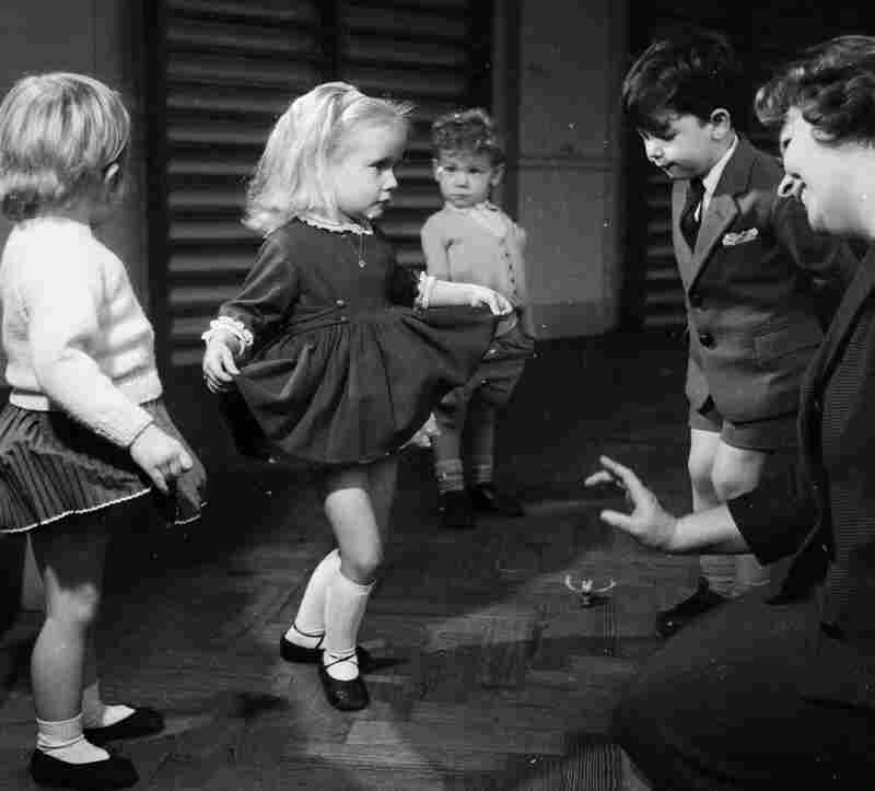 """Politeness seems to be falling by the wayside these days, with phrases like """"you're welcome"""" replaced by the more casual """"you bet"""" or """"no problem."""" Good manners were more the norm in 1960, when these kids at a junior theatrical school learned how to curtsy and bow."""