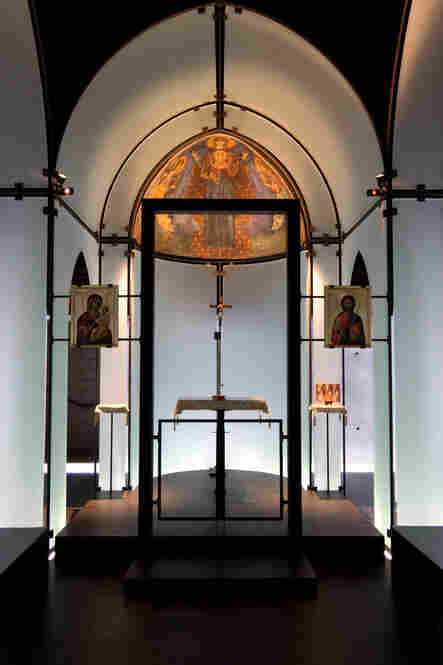 The glass and wood chapel that housed the frescoes was a church within a museum. The 4,000-square-foot chapel was opened in 1997 and funded by the Houston-based Menil Foundation.