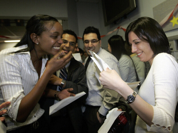 Boston University medical students Miriam Shiferaw, left, and Nawal Momani, right, check letters together to find out where they have been accepted for their residency during the Match Day at BU Medical School in Boston, Thursday, March, 15, 2007. W