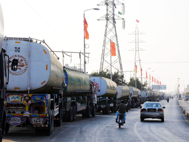 Oil tankers line the road near a NATO supply terminal in Karachi, on Feb. 9, 2012. Analysts say Pakistan is in no hurry to reopen the supply routes to Afghanistan, though truckers complain that they can't earn any money.