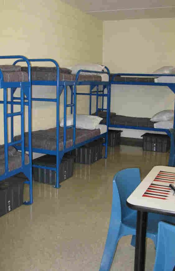 Detainees will sleep eight to a room, with a private bath, and will be permitted to move around the detention center largely unescorted.