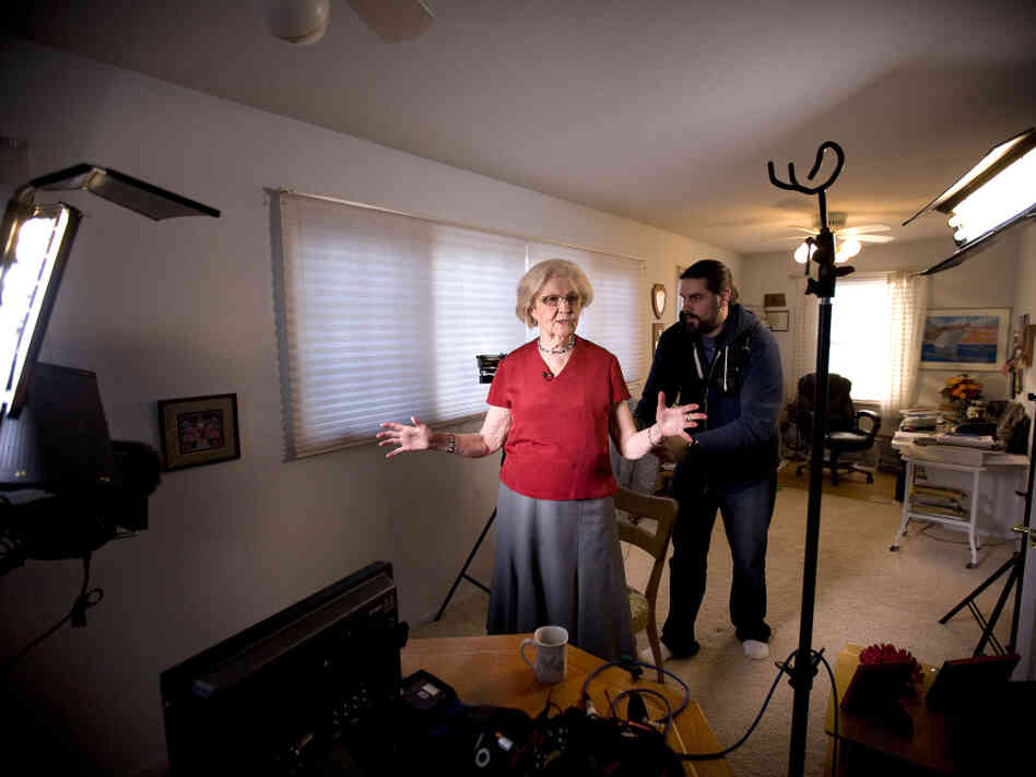 Columnist Marilyn Hagerty's den is converted into a makeshift television studio as a crew from CNN prepares her for an interview.