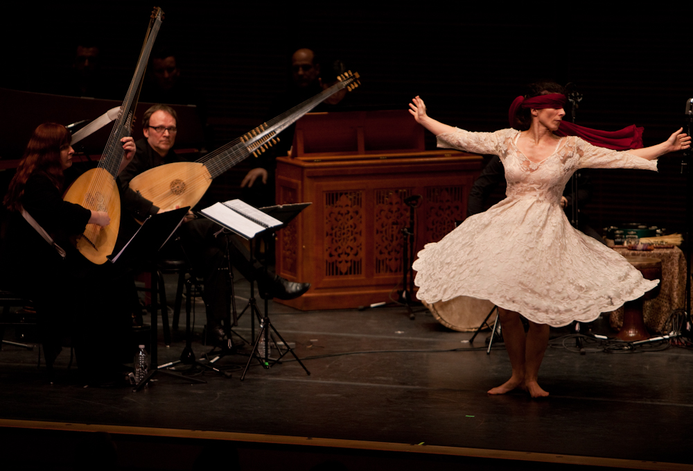 Dancer Anna Dega joined L'Arpeggiata with a blood red blindfold.