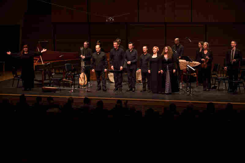 """Artistic Director Christina Pluhar (far left) ready to take a final bow with her group L'Arpeggiata and guest singers after a 70-minute uninterrupted performance of """"Via Crucis."""""""