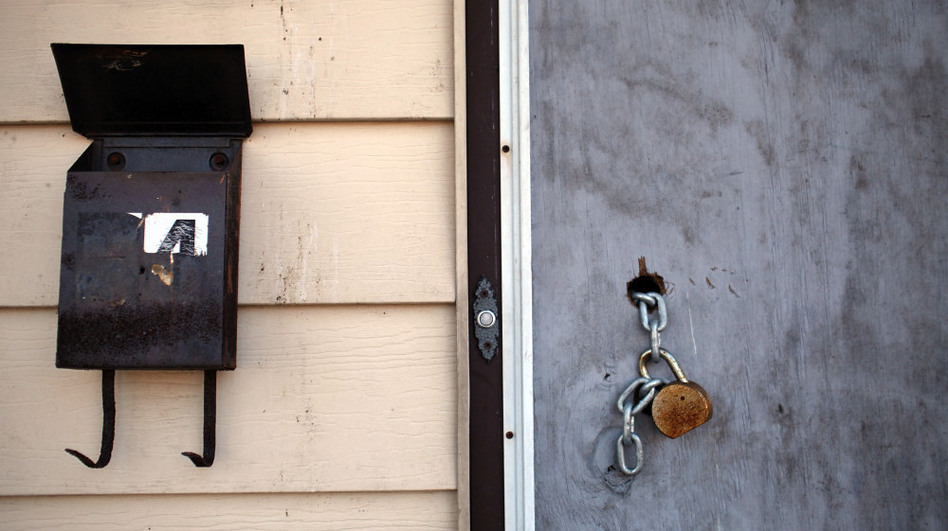 A padlock hangs from a door of a foreclosed home in Islip, N.Y. The time a foreclosure will take from start to finish varies widely from state to state.