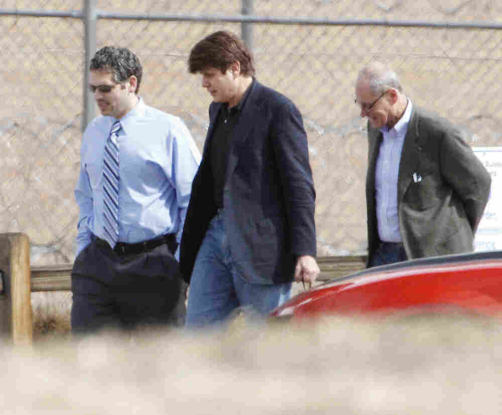 Former Illinois Gov. Rod Blagojevich, center, walks with attorneys as he arrives at the Federal Correctional Institution Englewood in Littleton, Colo., on Thursday.