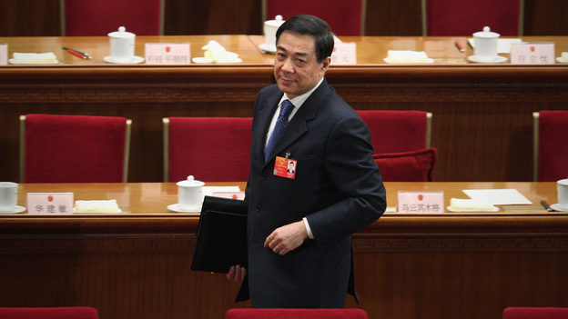 Chongqing Municipality Communist Party Secretary Bo Xilai leaves after the third plenary meeting of the National People's Congress at The Great Hall of the People in Beijing on March 9. Bo had been seen as a leading contender to access the top rungs of power in China, but in a dramatic reversal of fortune, he was sacked Thursday amid a rare public scandal. (Getty Images)