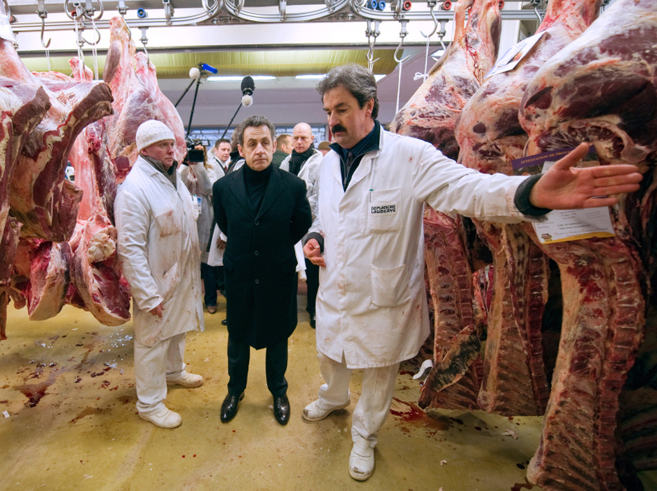 French President Nicolas Sarkozy listens to a butcher during a visit to the butchery pavilion at the Rungis international food market, near Paris, in February.  (Anna Maria Jakub/Getty Images)