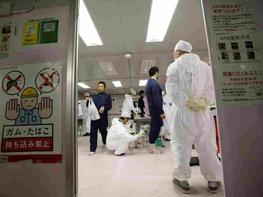 Workers are given radiation screenings as they enter the emergency operation center at Tokyo Electric Power Co.'s Fukushima Dai-Ichi nuclear power plant.