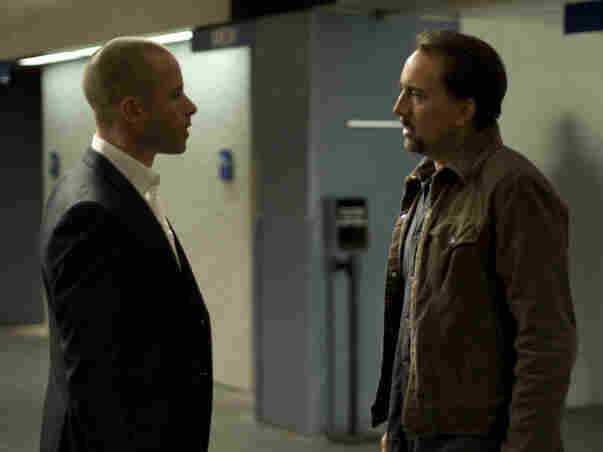Cage's Gerard improbably accepts an offer from a man known as Simon (Guy Pearce) who knows a bit too much about him and the trauma Gerard's wife has just endured.