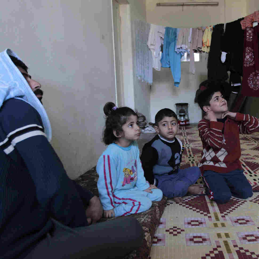 A family of Syrian refugees in a camp set up near the Jordanian city of Mafraq, near the Syrian border. Jordan has welcomed Syrian refugees, but has limited resources to help them.