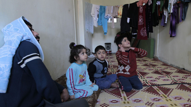 A family of Syrian refugees in a camp set up near the Jordanian city of Mafraq, near the Syrian border. Jordan has welcomed Syrian refugees, but has limited resources to help them. (AFP/Getty Images)