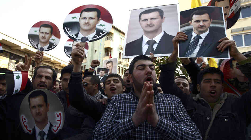 Syrians and Turks show their support for Syrian President Bashar Assad in Turkey's southern city of Antakya on