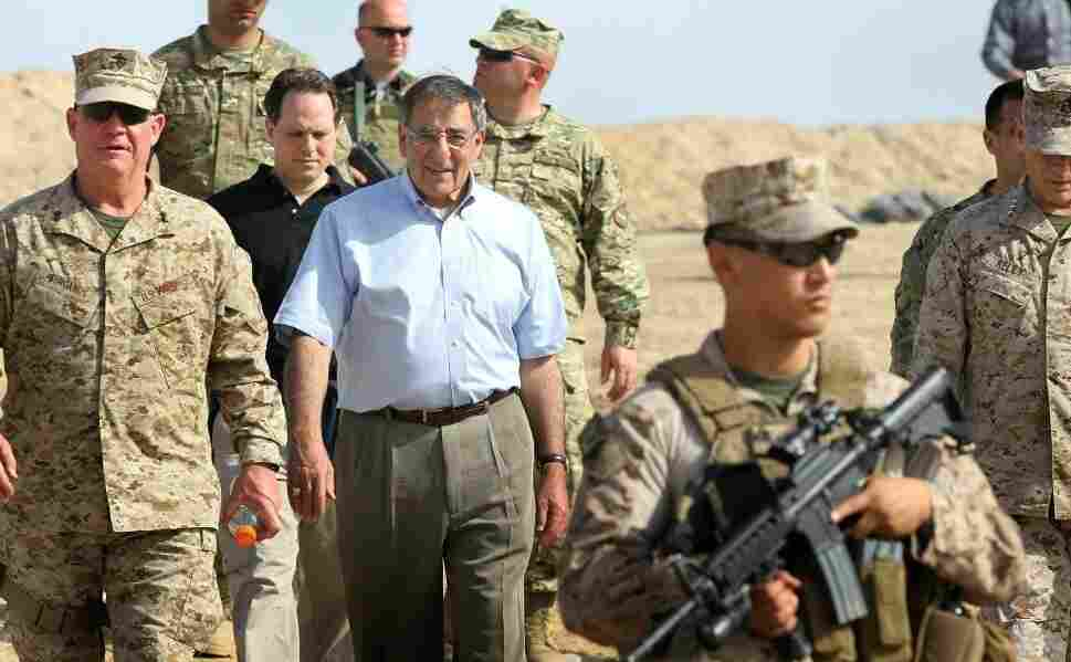 Above, U.S. Secretary of Defense Leon Panetta leaves after visiting with troops on March 14 at the Foward Operating Base in Shukvani, Afghanistan. Panetta was also scheduled to meet with Afghan President Hamid Karzai during his two-day visit.