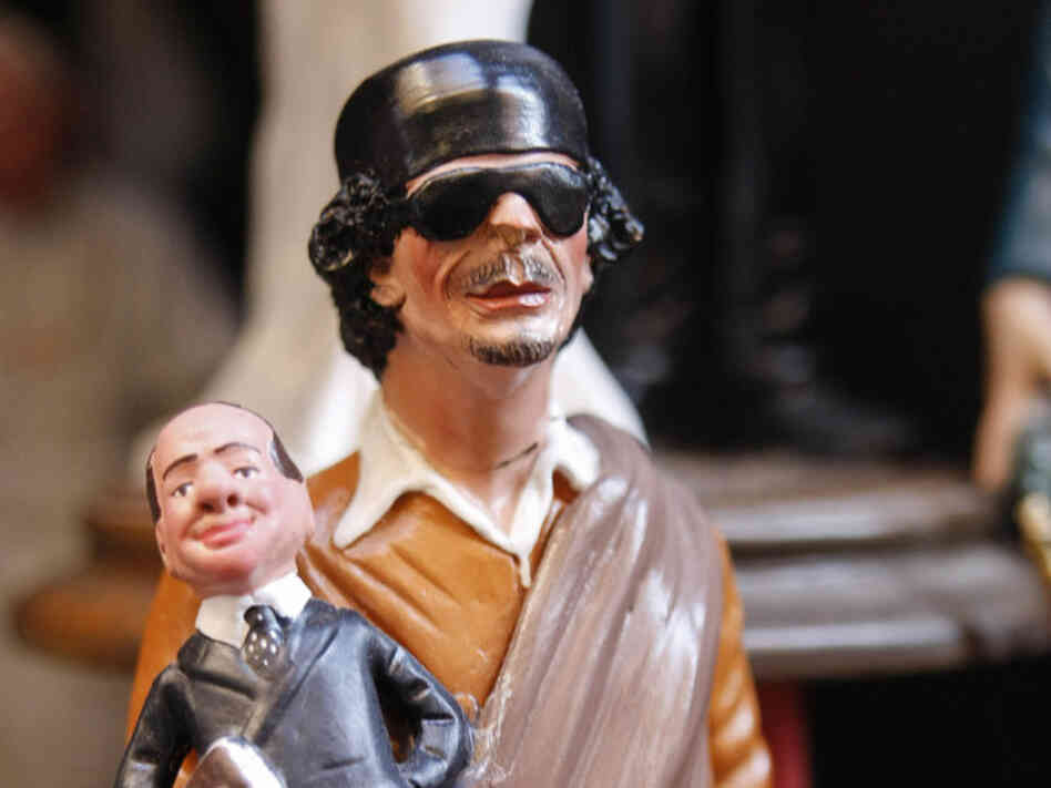 Crib figurines depicting former Libyan leader Moammar Gadhafi holding Italian Prime Minister Silvio Berlusconi are displayed in a shop in Via San Gregorio Armeno in Naples on December 20, 2011. Gadhafi was not the only dictator with eccentric tastes.