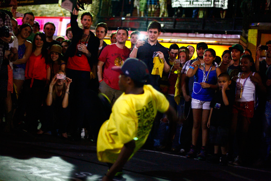 Break dancers perform on 6th Street at SXSW in Austin, Texas.