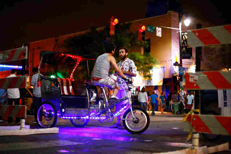 Old and busted: Getting to that Tanlines show by foot. The new hotness: Purple light rickshaws.