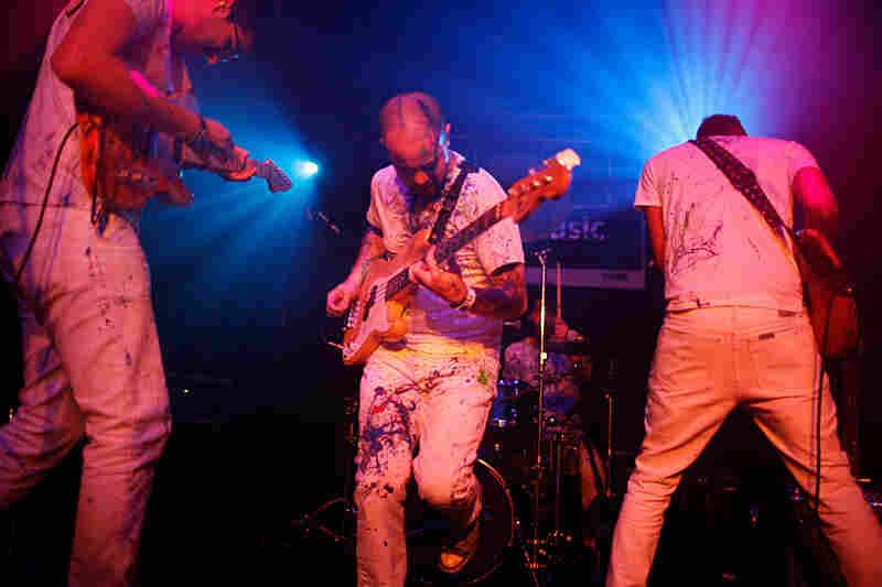 Wearing paint-splattered clothes, the Venezuelan dance-rock band La Vida Boheme kicked off NPR Music's day party at The Parish in Austin, Texas with chant-along songs and stage-shaking energy.