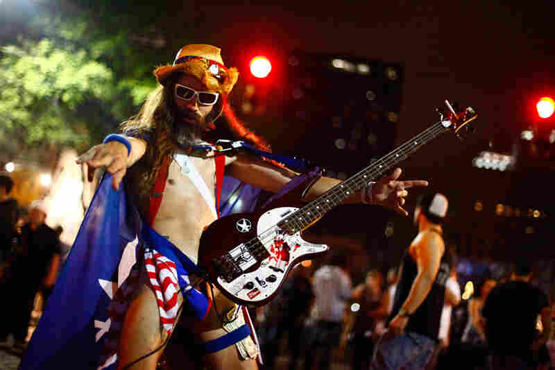 New York City's Naked Cowboy has a little-known cousin in Austin. We didn't catch his name, but we'd like to think it's The Naked Guy Who, For Reasons Of Pure Geography, Could More Likely Be Called An Actual Cowboy.