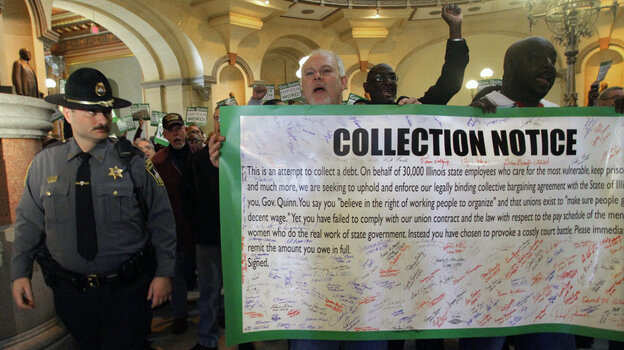 Union members rally outside of Illinois Gov. Pat Quinn's office on Feb. 2, demanding pay raises he withheld. Quinn said the state doesn't have the money to cover the raises.